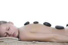 Masaje de piedra caliente foto de archivo libre de regalías