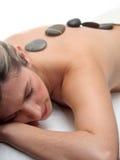 Masaje de piedra caliente Fotografía de archivo libre de regalías