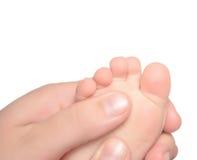 Masaje del pie del bebé Imagen de archivo