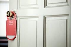 Masaje en la perilla de puerta Fotos de archivo