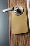 Masaje en la perilla de puerta Imagenes de archivo