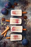 Masala chai latte popsicles with figs on cinnamon sticks. Spiced ice lollies for fall, winter season. Christmas holiday dessert Royalty Free Stock Photo