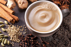 Masala Chai Latte Tea Cup. A cup of chai tea with cinnamon, cloves, fennel seeds, cardamon, ginger, star anise and black tea stock photo