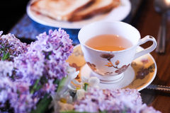 Masala chai tea of india with bread, butter and lilac flower Stock Photography