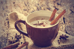 Masala chai tea with spices and star Anise, cinnamon stick, peppercorn Stock Photos