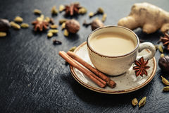 Masala chai tea. Traditional indian drink - masala chai tea milk tea with spices on black slate  background Stock Photo