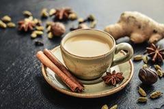 Masala chai tea. Traditional indian drink - masala chai tea milk tea with spices on black slate  background Stock Photography