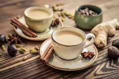 Masala chai tea. Traditional indian drink - masala chai tea milk tea with spices on wooden background Royalty Free Stock Photos