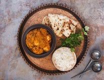 Masala do tikka da galinha com arroz do pulao e pão naan Fotografia de Stock