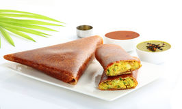 Masala dosa. With different types of chutney and sambar. This is a closeup shot of one of the most famous indian snack Stock Photography
