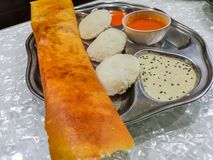 Masala Dosa and Idli Dosa food closeup with selective focus and crop fragment. It is a popular South Indian all time food stock photo