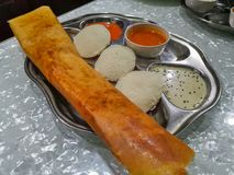 Masala Dosa and Idli Dosa food closeup with selective focus and crop fragment. It is a popular South Indian all time food stock photography
