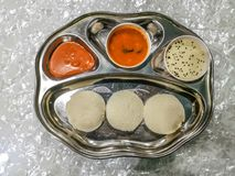 Masala Dosa and Idli Dosa food closeup with selective focus and crop fragment. It is a popular South Indian all time food stock image