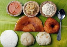 Masala dosa, idly, vada, chutney, upma and sambar. Masala dosa, idly, vada, chutney, upma, curry and sambar on a banana leaf Stock Photos