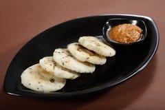 Masala Idli, wohlschmeckender Reis-Kuchen lizenzfreie stockfotografie