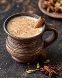 Masala pulled tea chai latte delicious hot Indian sweet milk spiced drink, ginger, fresh spices beverage Royalty Free Stock Photography
