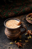 Masala pulled tea chai latte hot Indian sweet milk spiced drink, cinnamon stick, ginger, fresh spices and herbs blend Stock Images