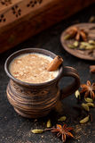 Masala pulled tea chai latte hot Indian sweet milk spiced drink, nutmeg, fresh spices and herbs blend Royalty Free Stock Photos