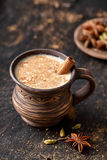 Masala pulled tea chai latte tasty hot Indian sweet milk spiced drink, ginger, fresh spices and herbs blend Stock Photos