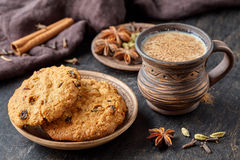 Masala pulled tea chai latte traditional hot Indian sweet milk spiced drink, fresh spices blend Royalty Free Stock Photo