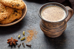 Masala pulled tea chai latte traditional hot Indian sweet milk spiced drink, ginger, Stock Image