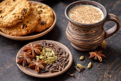Masala pulled tea chai latte traditional hot Indian sweet milk spiced drink, ginger, nutmeg fresh spices blend Stock Images