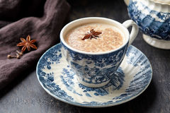 Masala tea chai latte traditional hot Indian sweet milk drink with spiced ingridients, ginger, herbs, spices blend Royalty Free Stock Images