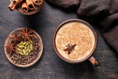Masala tea chai latte traditional hot Indian sweet milk spiced drink, ginger, cinammon sticks, fresh spices blend Royalty Free Stock Photos