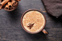 Masala tea chai latte traditional warm Indian sweet milk spiced drink, ginger, cinammon sticks, fresh spices blend Royalty Free Stock Photography