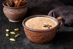 Masala tea chai latte traditional warm Indian sweet milk spiced drink, ginger, green cardamom, spices blend Stock Photography