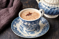 Masala tea chai latte traditional warm Indian sweet milk with spices, cinnamon stick, ginger herbs blend. Organic infusion healthy wellness beverage in Royalty Free Stock Image