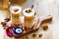 Masala tea. In glass jars with spices and glass amulet Evil Eye Royalty Free Stock Images