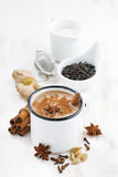Masala tea and ingredients, vertical Royalty Free Stock Images