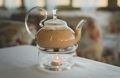 Masala tea in a transparent teapot. stock images