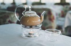 Masala tea in a transparent teapot. royalty free stock images