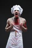 Masarka mężczyzna agresywny maniacki szef kuchni w krwi Zdjęcie Royalty Free