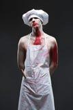 Masarka mężczyzna agresywny maniacki szef kuchni w krwi Fotografia Stock