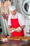 Masarki mienia mięso W Butchery Obrazy Stock