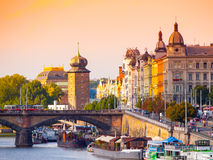 Masaryk Embankment with and Sitkovska water tower Palacky Bridge over Vltava River in Prague city centre, Czech Republic.  Stock Photos