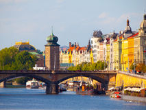 Masaryk Embankment with and Sitkovska water tower Palacky Bridge over Vltava River in Prague city centre, Czech Republic.  Royalty Free Stock Photography
