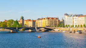 Masaryk Embankment with and Sitkovska water tower Palacky Bridge over Vltava River in Prague city centre, Czech Republic royalty free stock images