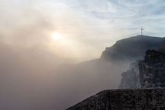 Masaya volcano with smoke ans cross in the mountain Royalty Free Stock Photography