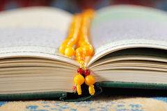The Masbaha, also known as Tasbih with the Quran Royalty Free Stock Photo