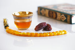 Masbaha, Quran, Arabic tea and dried dates are symbols of Ramadan Royalty Free Stock Photo