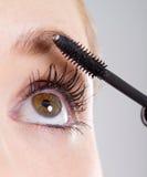 Mascara. Young woman makeup with mascara eye closeup Royalty Free Stock Photo