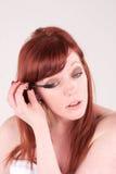 Mascara. A woman applying her mascara Stock Photos