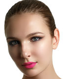 Mascara Applying. Long Lashes closeup. Mascara Brush. Eyelashes. Extensions. Makeup for Blue Eyes. Eye Make up Apply, pink lips Royalty Free Stock Image