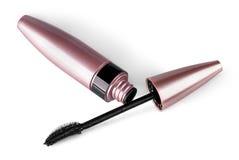 Mascara and brush lying beside Stock Photo