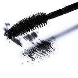 Mascara brush over white background. Closeup of mascara brush over white background Stock Image