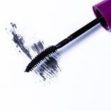 Mascara brush over white background. Closeup of mascara brush over white background Royalty Free Stock Image